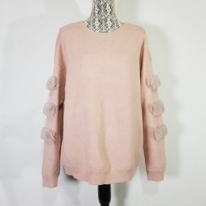 Large pink sweater with faux fur details
